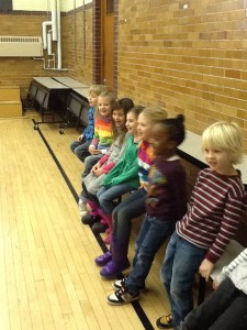 Cheering on classmates during the penguin race